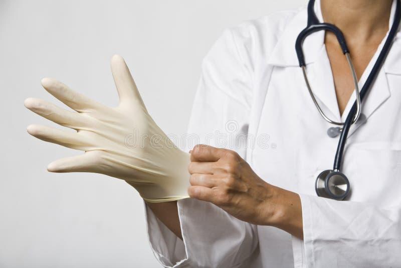surgial rękawiczkowy kładzenie obraz stock