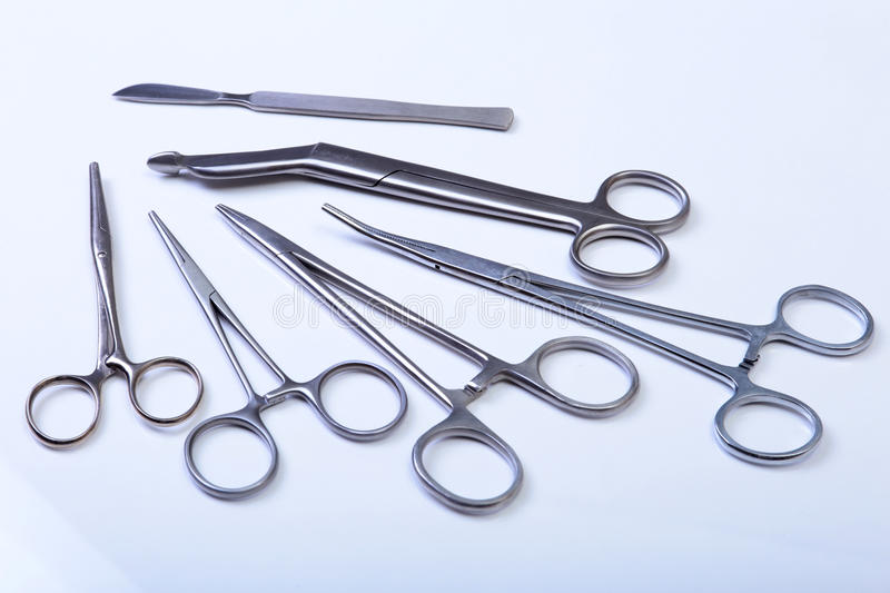 Surgical instruments and tools including scalpels, forceps tweezers arranged on a table for surgery. Surgical instruments and tools including scalpels, forceps royalty free stock photos