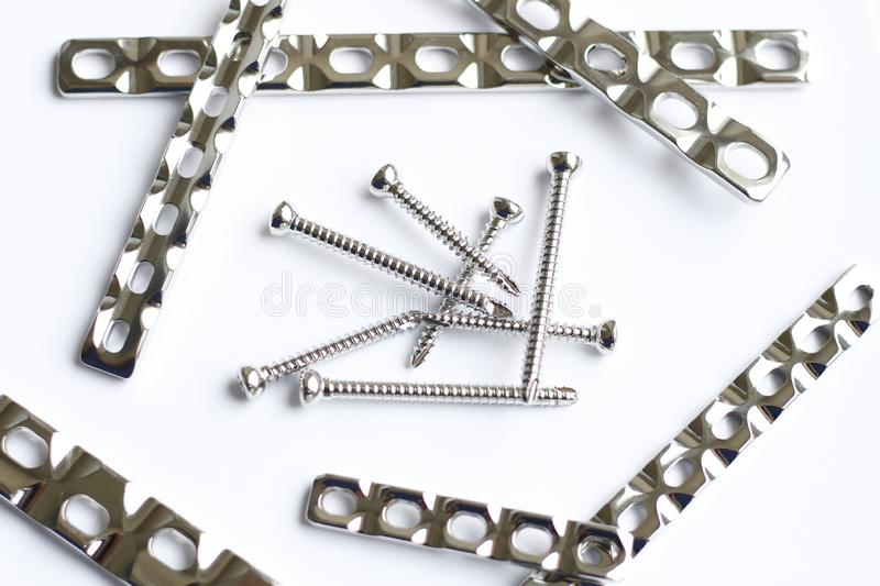 Surgical platesvand screws for operation in traumatology royalty free stock photo