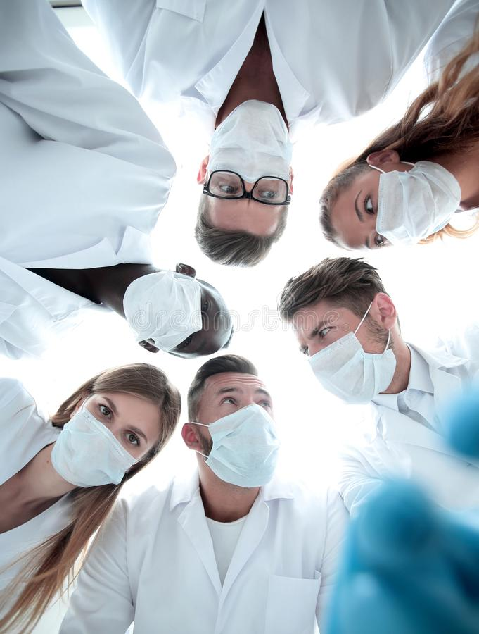 Surgeons looking down patient hospital royalty free stock images