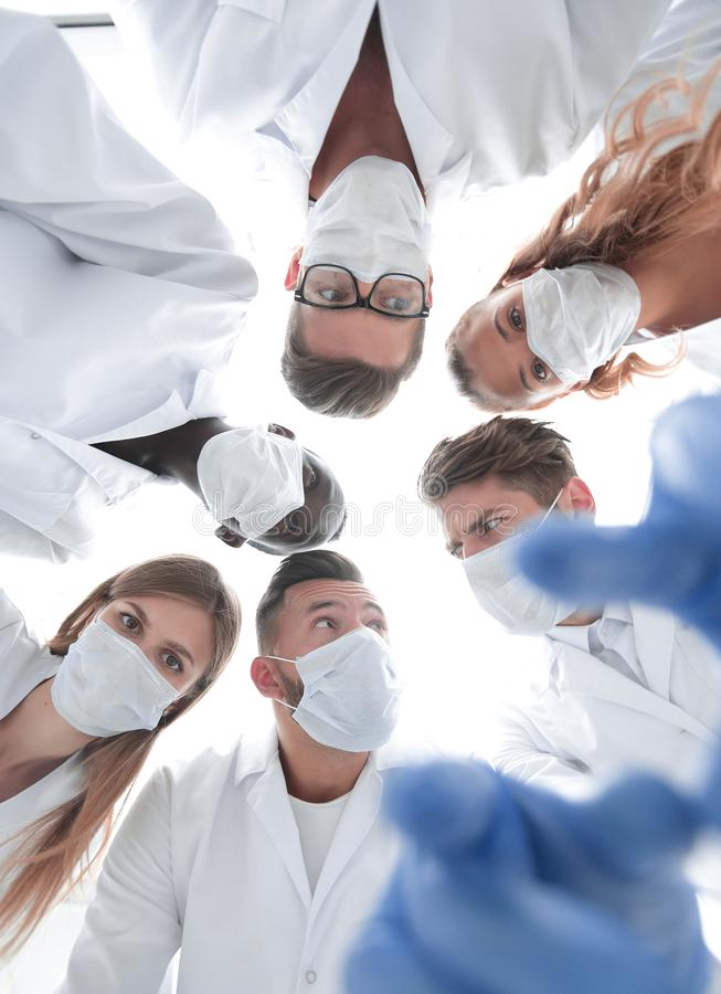 Surgeons looking down patient hospital stock photo