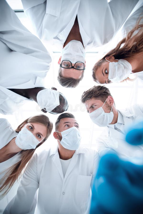 Surgeons looking down patient hospital royalty free stock photos