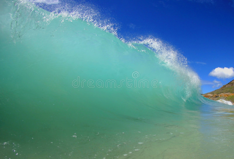 Surging Wave. A breaking wave at Sandy Beach on the island of Oahu, Hawaii stock photo