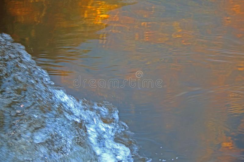 SURGING WHITE WATER CONTRASTING WITH CLEAR TRANSLUCENT WATER WATER royalty free stock photos