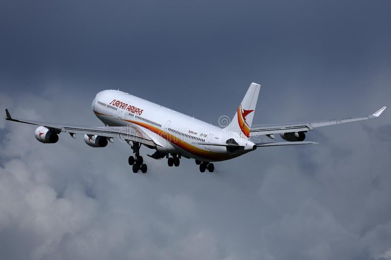 Surinam Airways jet flying up to holiday destinations. Surinam Airways plane taking off from runway, blue sky with clouds stock photography