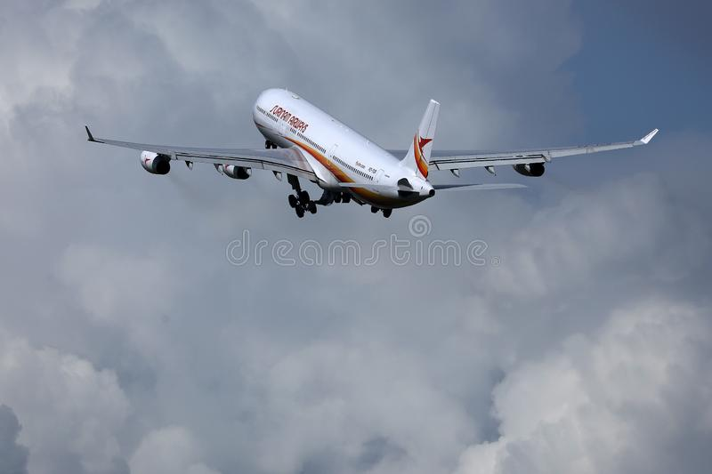 Surinam Airways jet flying up to holiday destinations. Surinam Airways plane taking off from runway, blue sky with clouds stock photos