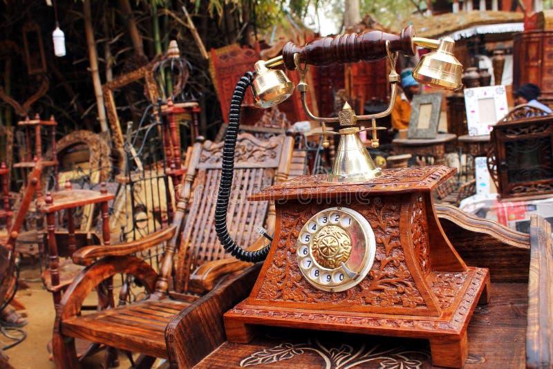 SURJAJKUND FAIR, HARYANA - FEB 12 : antique wooden telephone for stock image