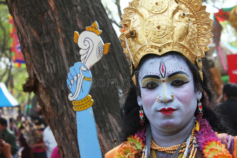 SURJAJKUND FAIR, HARYANA - FEB 12 : artist in vishnu avatar royalty free stock images