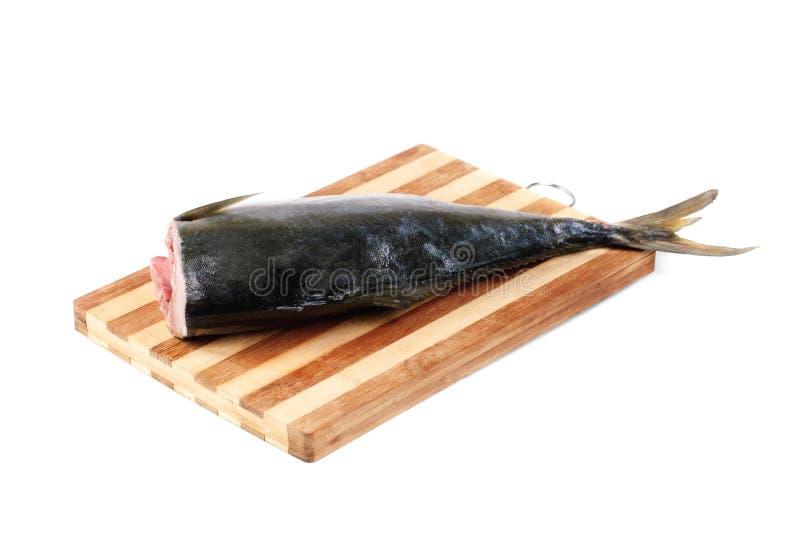 Surowa tuńczyk un tnąca deska odizolowywająca na bielu fotografia stock