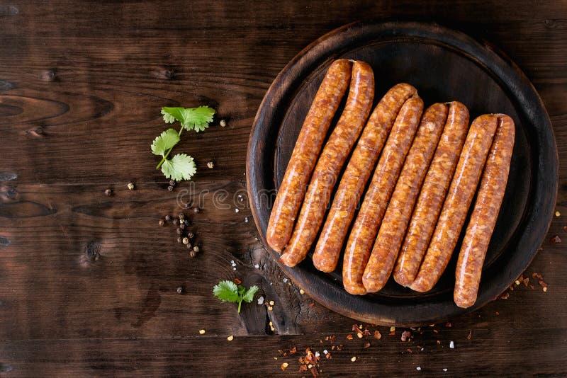 Surowe kiełbasy dla BBQ obraz royalty free