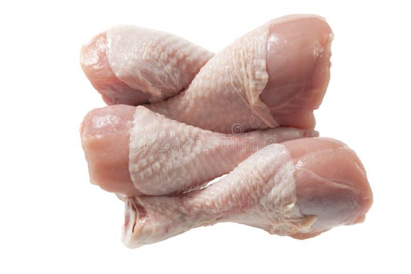 Surowe kurczak nogi na bielu zdjęcia stock