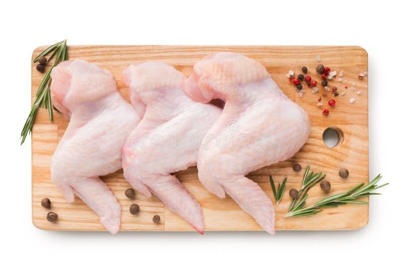 Surowi kurczaków skrzydła z składnikami obraz royalty free