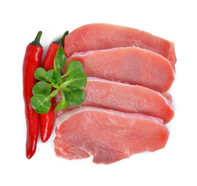 Surowy świeży mięso z chili pieprzami fotografia royalty free