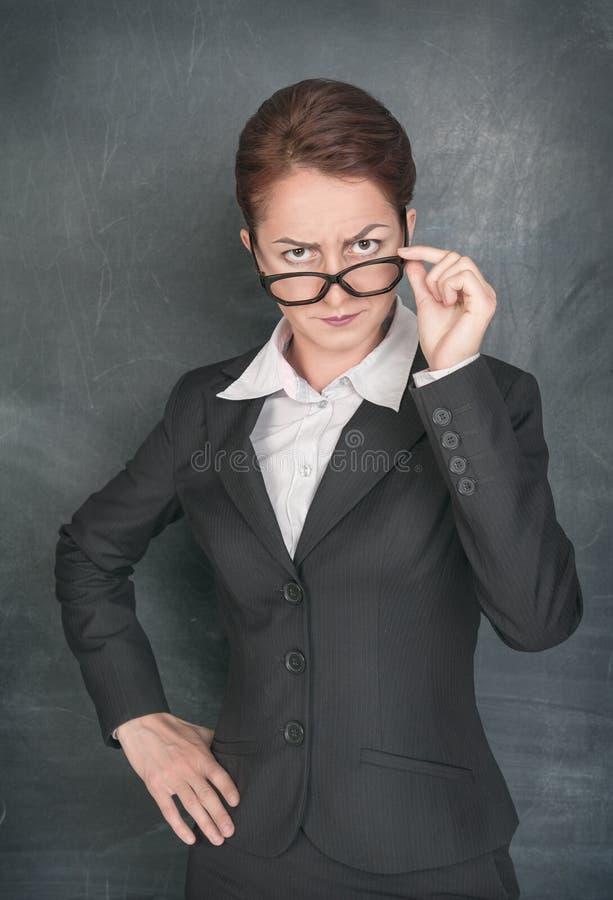 Surowy nauczyciel patrzeje someone zdjęcia royalty free