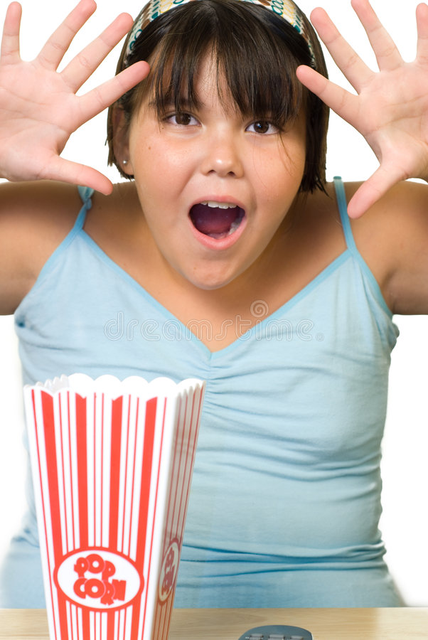 Surprise. A young girl making a surprised face, pretending her movie is scary stock image