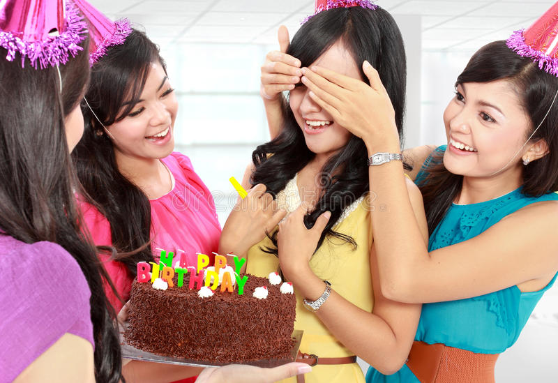 Surprise birthday party. Young beautiful women blindfold during surprise birthday party stock image