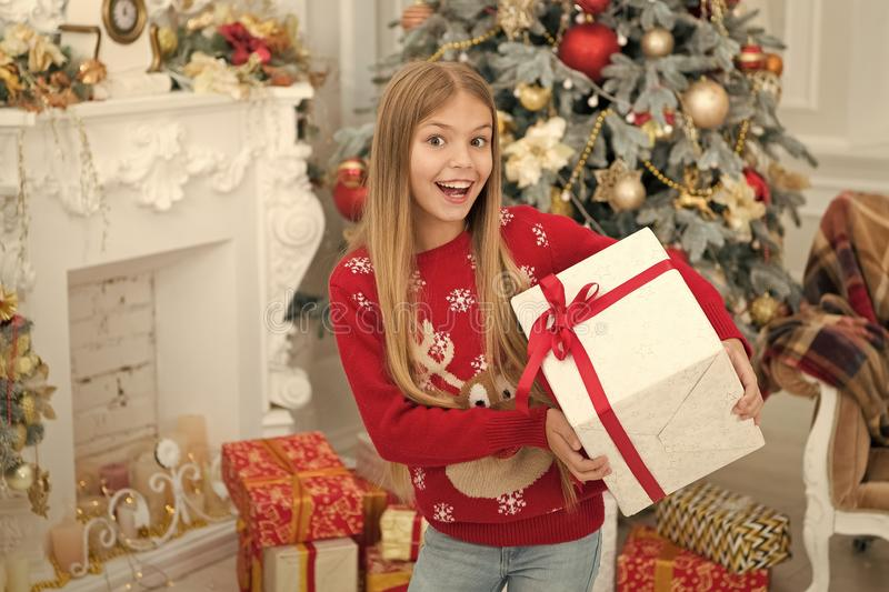 Surprise. Child enjoy the holiday. Christmas tree and presents. Happy new year. Winter. xmas online shopping. Family. Holiday. The morning before Xmas. Little stock photos