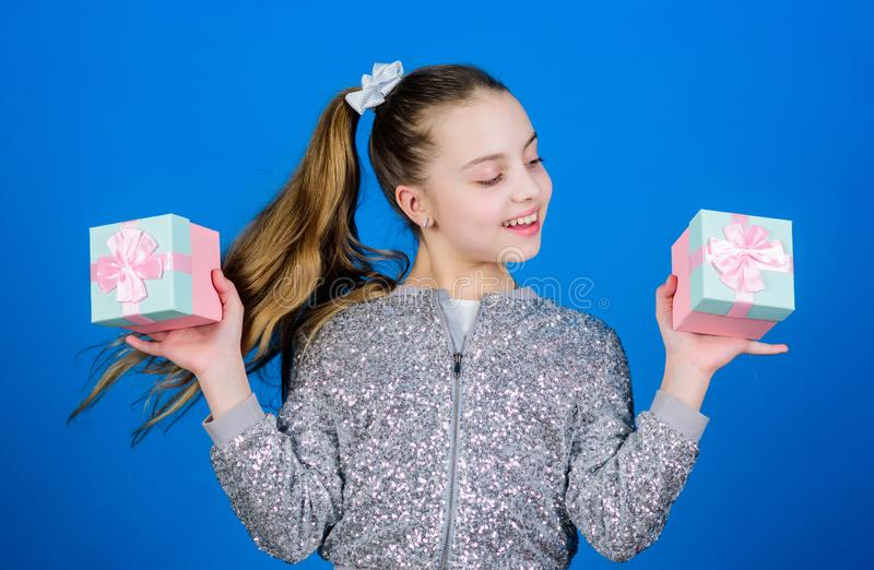 Surprise. Childrens day. Congratulation. Happy birthday. Holiday celebration. Small girl with present box. Boxing day. Christmas shopping. Cheerful child stock images