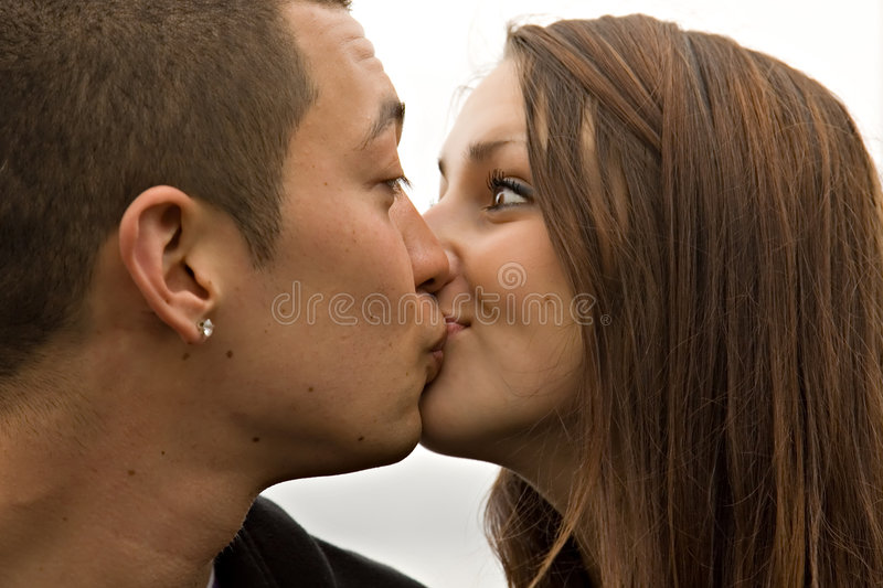 Surprise Kiss Young Couple stock photo