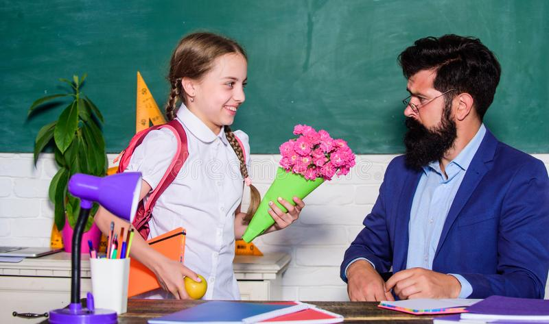 Surprise. knowledge day is 1 september. small school girl kid with flower bouquet. teachers day. Daugghter and father. With flowers. back to school. Happy stock photography
