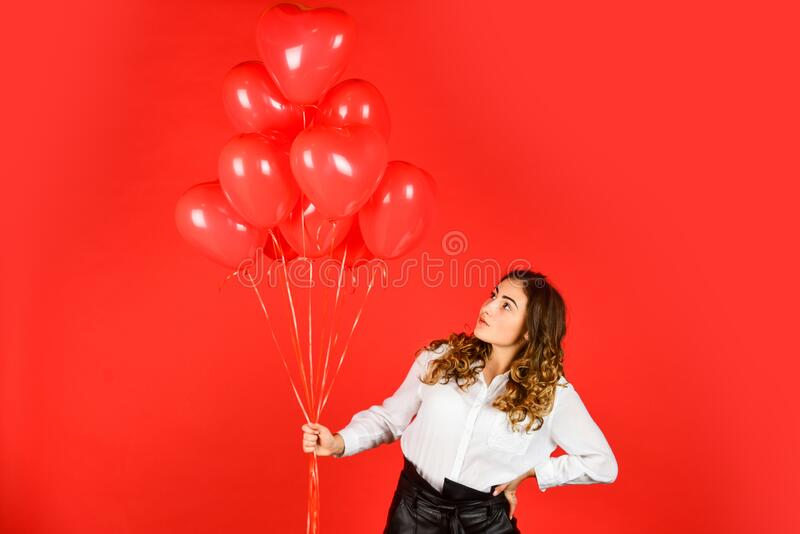 Surprise with love. Helium balloons for party. Gift for girlfriend. Festive mood. Impressive present. Happy valentines royalty free stock image