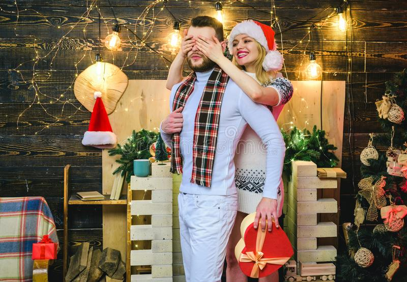 Surprise for sweetheart. Merry christmas and happy new year. Christmas gifts. Man handsome with gift box surprise for. Girlfriend. Man hipster give gift to girl stock photo
