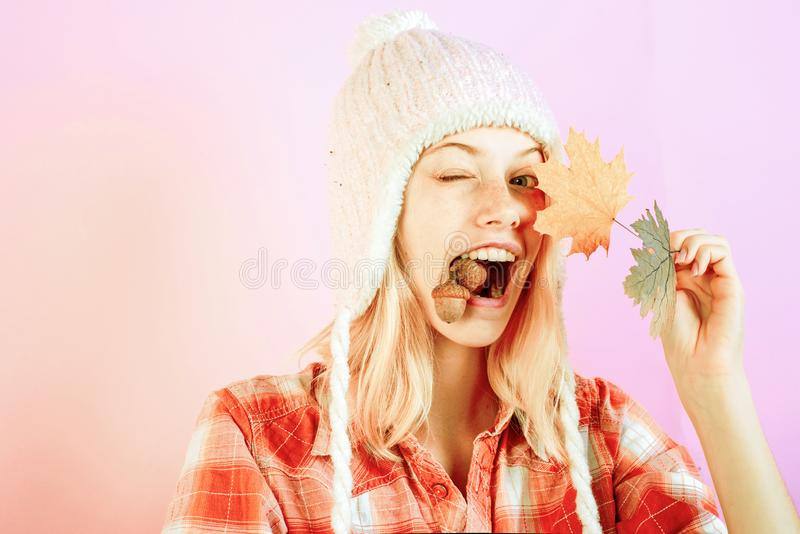 Surprise woman playing with leaves and looking at camera. Girl in autumn are getting ready for autumn sale. Girl in royalty free stock photography