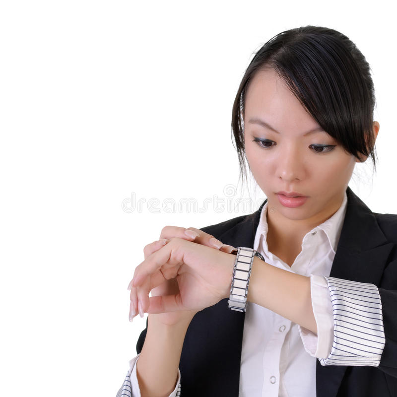 Surprised. Business woman looking watch with surprised expression, closeup portrait with white copyspace stock photo