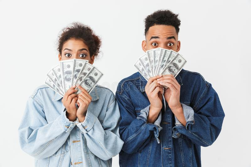 Surprised african couple in denim shirts covering their faces stock photo