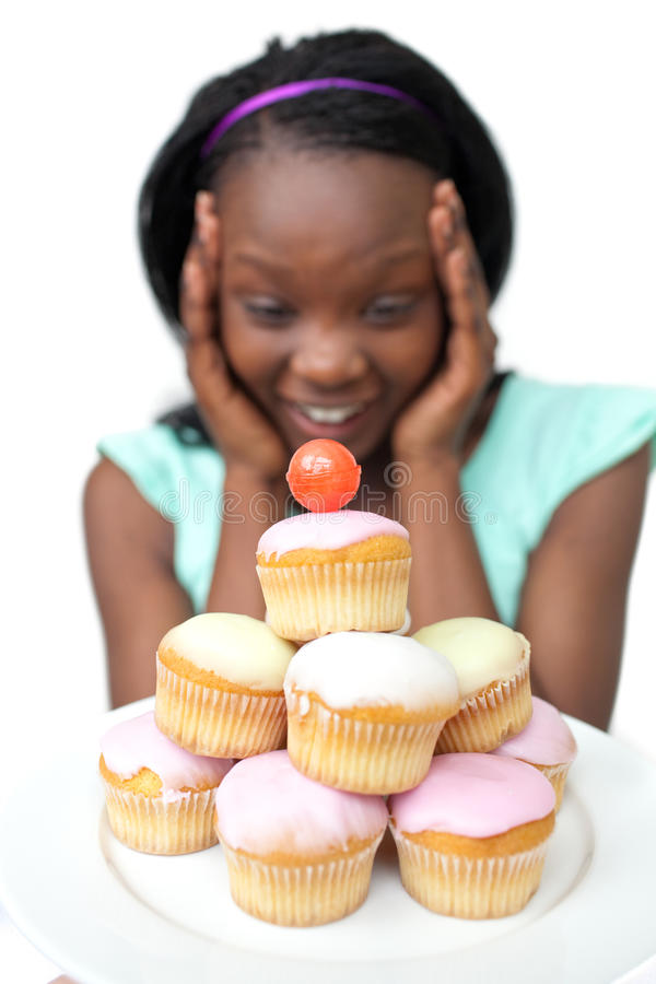 Surprised african woman looking at cakes stock images