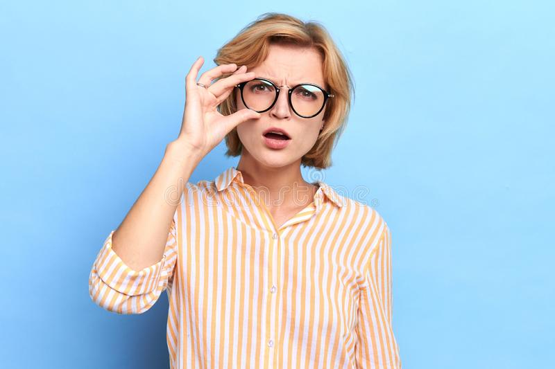 Surprised amazed girl taking off her glasses royalty free stock photos