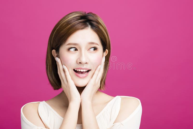 Surprised young beauty looks aside royalty free stock photos