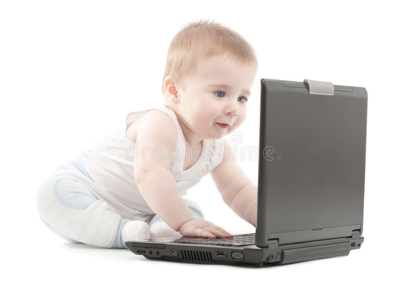 Surprised baby boy express working on laptop stock photos