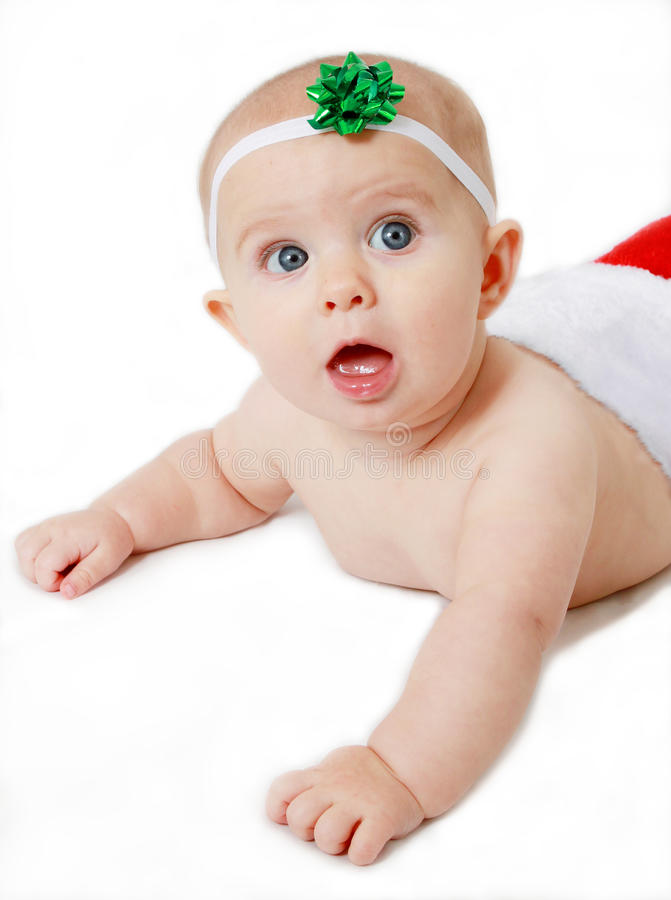 Surprised baby in a Christmas stocking royalty free stock photos