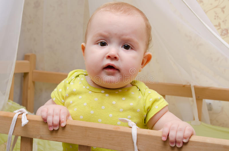 Surprised baby in a cot stock photos