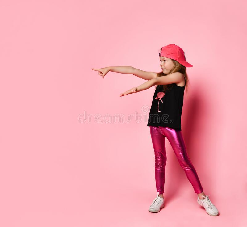 Education, school and gesture concept - cute little girl pointing to the side royalty free stock images