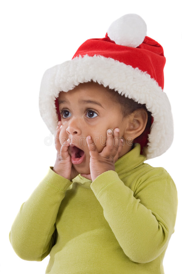 Surprised baby girl with red hat of Christmas stock images