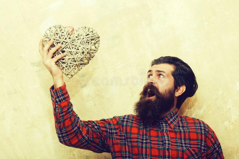 Surprised bearded man shouting with wicker heart stock image