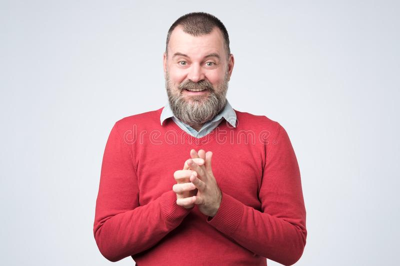Surprised bearded man standing with open mouth. stock image