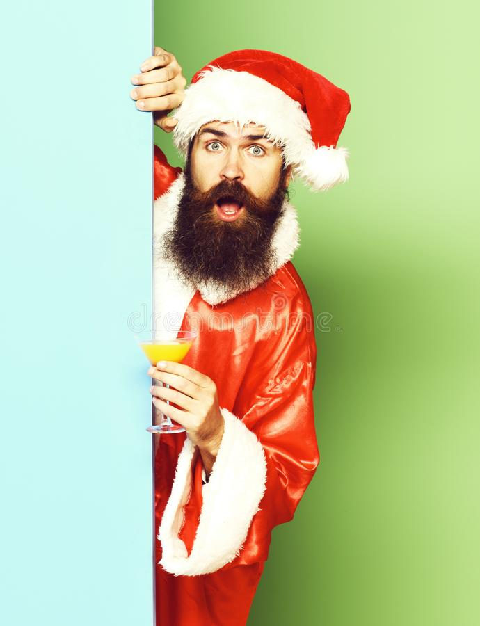 Surprised bearded santa claus man with long beard royalty free stock photography