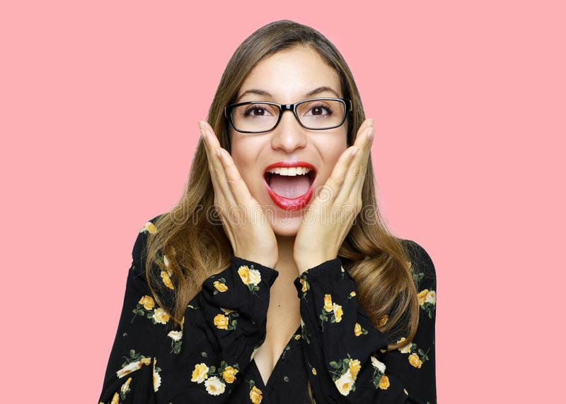 Surprised beautiful young woman holds cheeks by hand and wear glasses.  royalty free stock photo