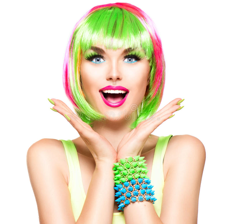 Surprised beauty model girl with colorful dyed hair royalty free stock photography
