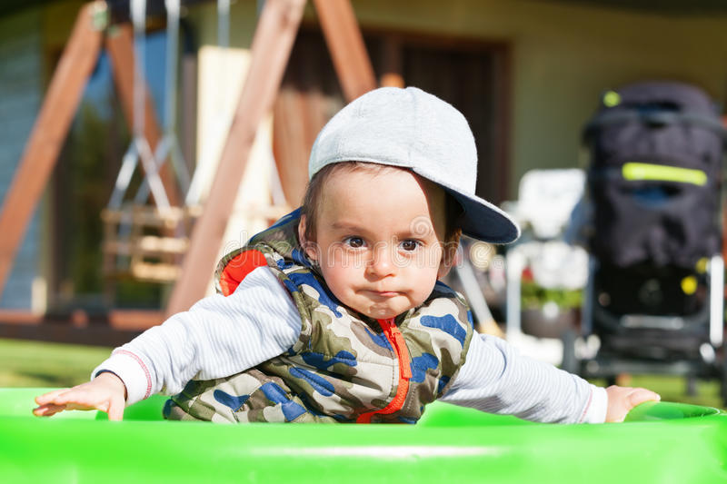 Surprised boy. Surprised arabic boy playing outdoors stock photography