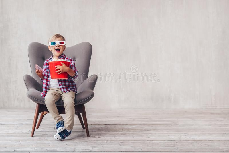 Surprised boy in 3d glasses with popcorn stock photos