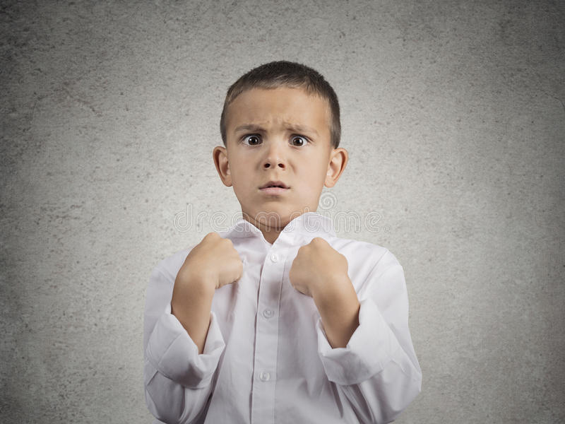 Surprised boy getting unexpected attention asking you talking to me? royalty free stock images