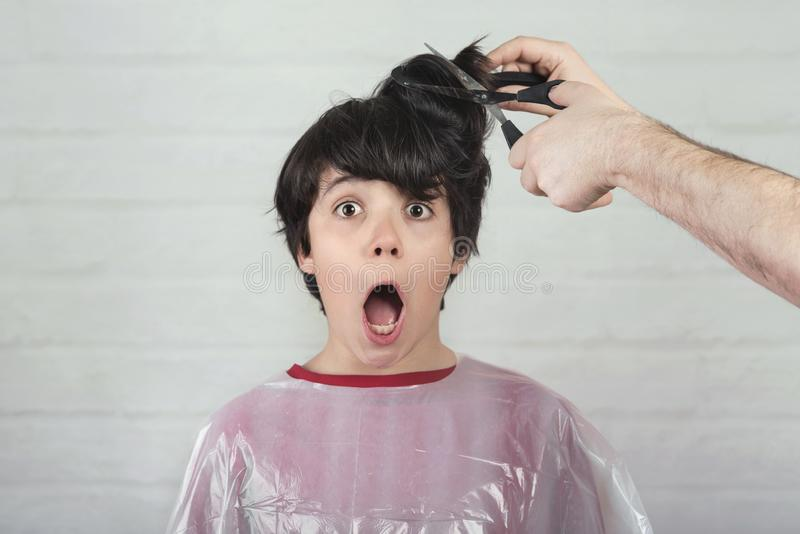 Surprised boy at the hairdresser royalty free stock photo