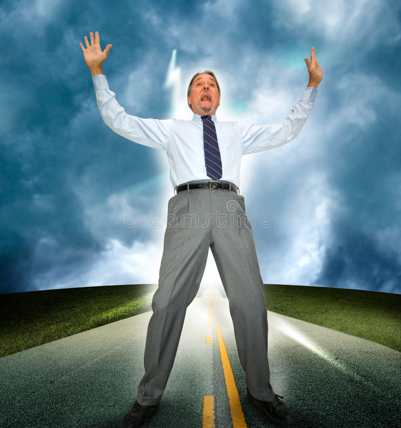 Surprised business man. A middle aged business man standing in an asphalt road reacts with shock and surprise as he is hit with a bolt of light or lightening royalty free stock image