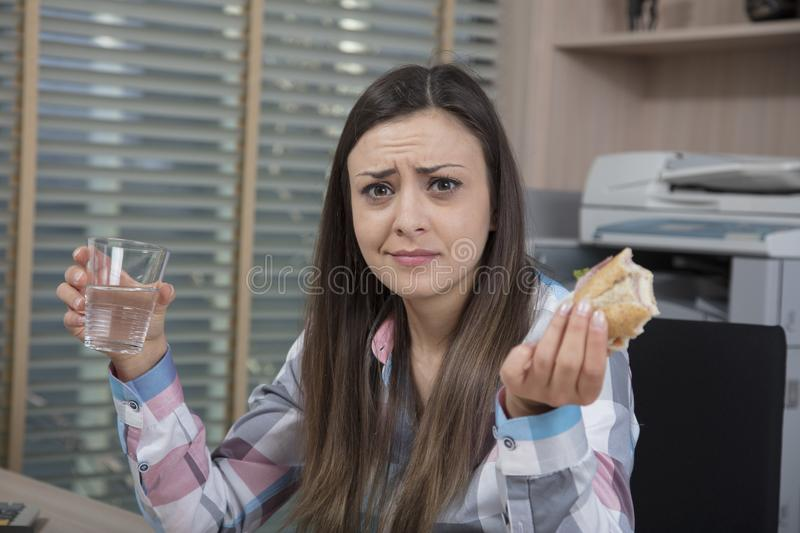 Surprised business woman eats a meal royalty free stock photos