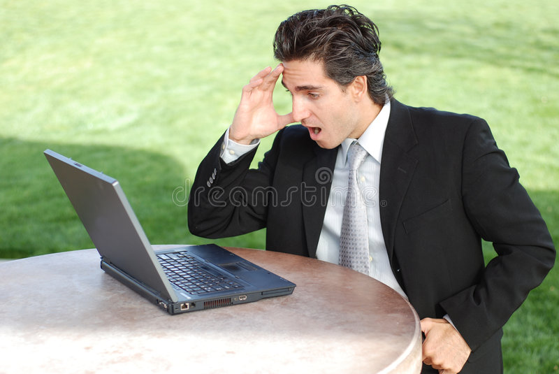 Surprised businessman stock images
