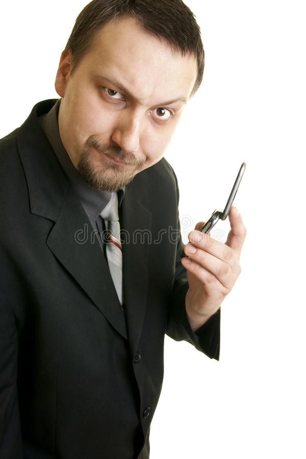 Surprised businessman holding the phone royalty free stock photos